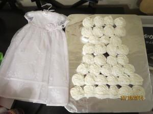 P's Baptism Dress next to Cupcake Dress