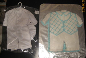 Baptism Cake next to outfit