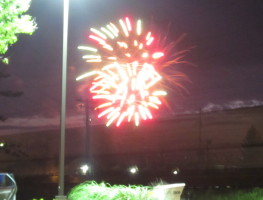 Fireworks with a train going by.