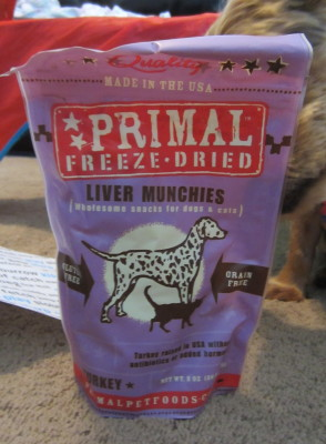 Primal Pet Freeze Dried Liver Munchies-Turkey, with Derby sniffing the bag