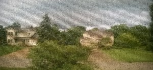 The end of the storm through my front window and screen.